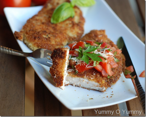 Chicken Parmesan with a tomato basil topping